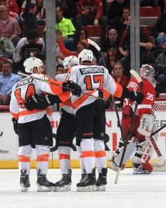 Claud Giroux celebrates with teammates after scoring in the third period.  (Photo by Dave Reginek/NHLI via Getty Images)
