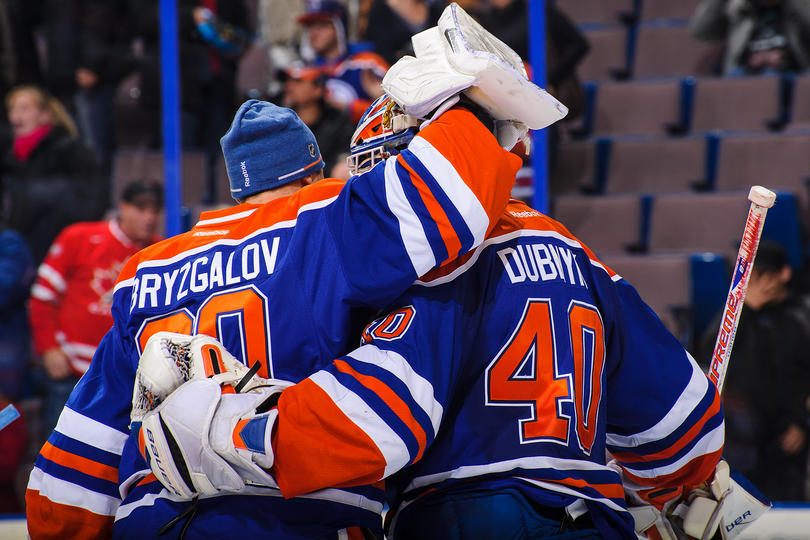 Ilya Bryzgalov #80 of the Edmonton Oilers congratulates his teammate Devan Dubnyk #40 after their victory over the Florida Panthers during an NHL game at Rexall Place on November 21, 2013 in Edmonton, Alberta, Canada. The Oilers defeated the Panthers 4-1. (Photo by Derek Leung/Getty Images)