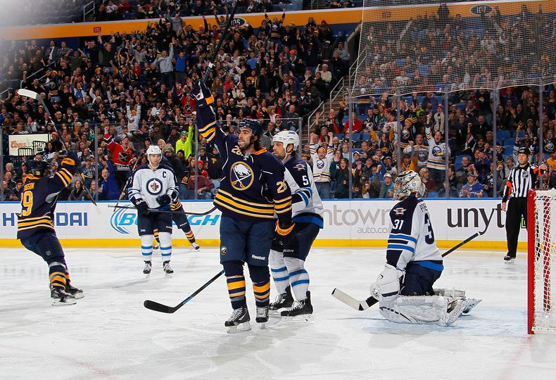 Matt Moulson celebrates third period goal against Winnipeg. (Photo by Bill Wippert/NHLI via Getty Images)