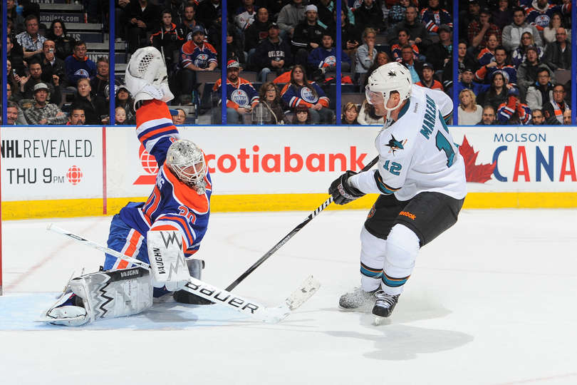 Ben Scrivens #30 of the Edmonton Oilers makes a save on a shot from Patrick Marleau #12 of the San Jose Sharks on January 29, 2014 at Rexall Place in Edmonton, Alberta, Canada. (Photo by Andy Devlin/NHLI via Getty Images)