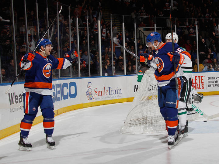 Peter Regin #16 of the New York Islanders (R) celebrates his goal at 9:29 of the second period along with Josh Bailey #12 (L) against the Dallas Stars. (Photo by Bruce Bennett/Getty Images)