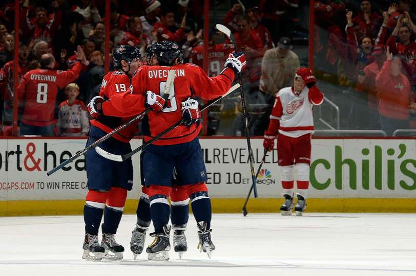 Alex Ovechkin #8 of the Washington Capitals celebrates with his teammates after scoring the game winning goal in overtime during an NHL game against the Detroit Red Wings at Verizon Center on February 2, 2014 in Washington, DC. The Washington Capitals defeated the Detroit Red Wings 6-5. (Photo by Patrick McDermott/NHLI via Getty Images)