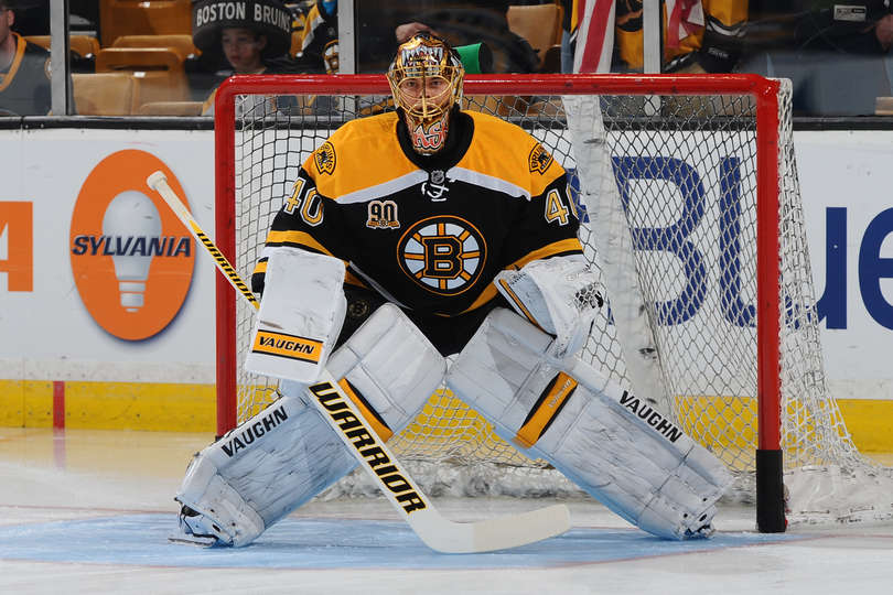 Tuukka Rask #40 of the Boston Bruins warms up before the game against the Vancouver Canucks at the TD Garden on February 4, 2014 in Boston, Massachusetts. (Photo by Steve Babineau/NHLI via Getty Images)